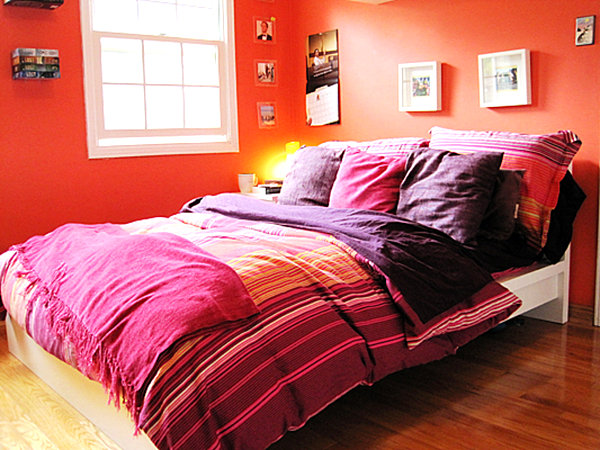 Tangerine bedroom with purple bedding