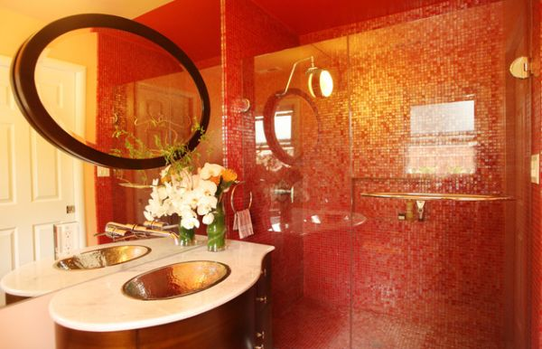 Vivid and vivacious bath uses red tiles and glass shower doors to create an Asian styled bath