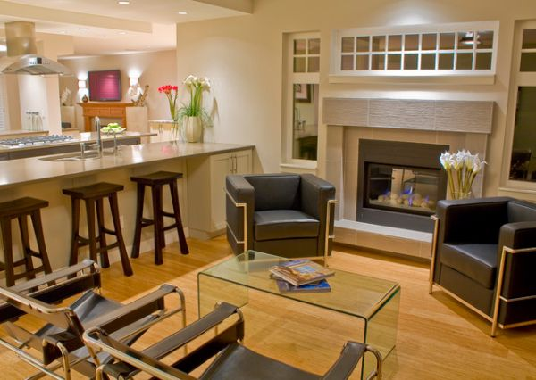 Wassily chairs along with sleek fireplace grace this gorgeous home