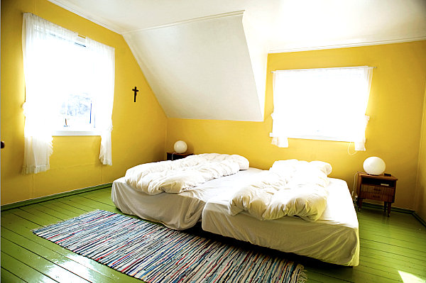 Eye catching paint colors for the bedroom Bright yellow wall paint