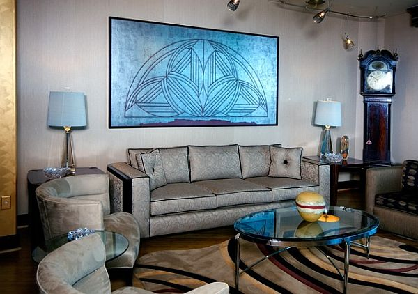 Art deco living room with silver couch and blue painting