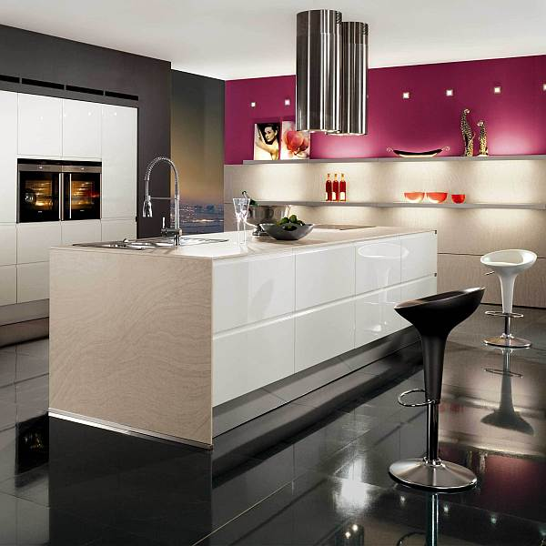 Kitchen decor with black walls, white island and pink cabinets