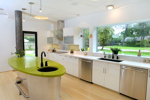 Bright colored kitchen with a modern design and green tones