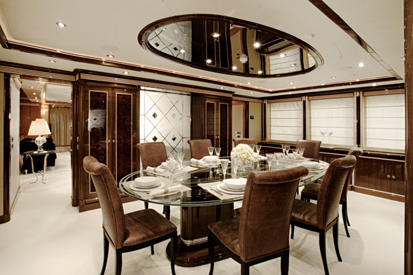 Dark brown and white dining room with art deco elements
