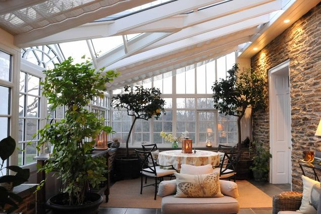 Choosing sunroom furniture to match your design style for Conservatory interior designs