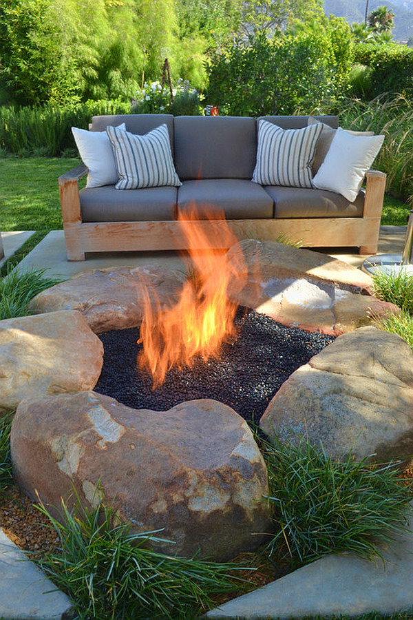 contemporary patio with rustic firepit