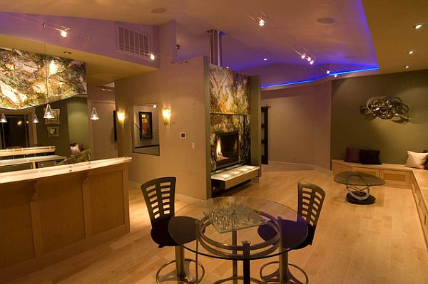 Contemporary rec room with purple LED ceiling lights