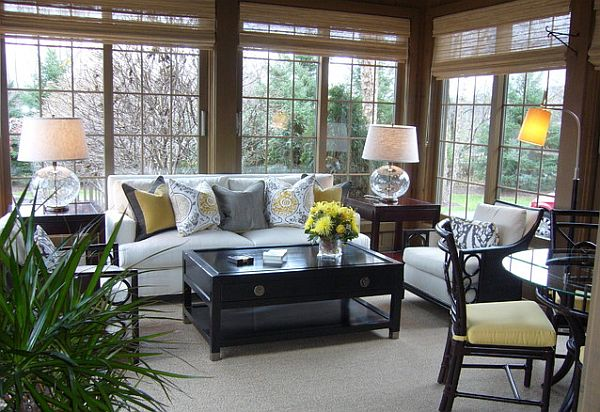 cozy sunroom design with couch and coffee table - Sunroom Decor