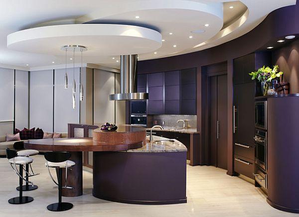 An elegant dark purple kitchen has a certain charm