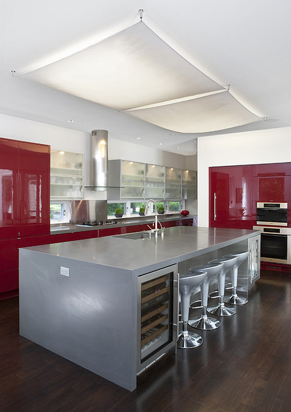 Glossy dark red cabinets and silver kitchen island