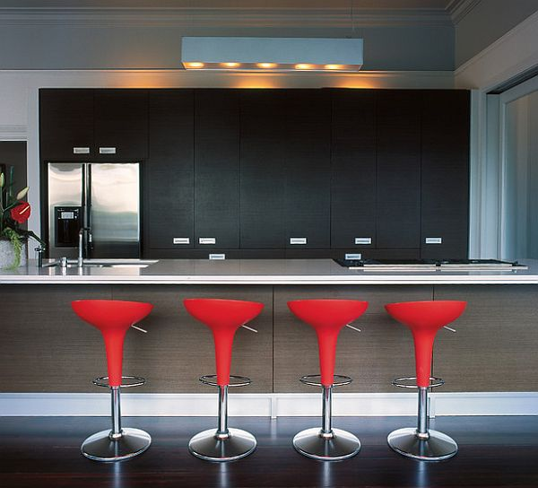 Ultra-modern kitchen with stylish bar stools in red