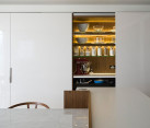 kitchen storage concealed behind sliding doors
