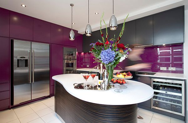 kitchen with purple cabinets and backsplash