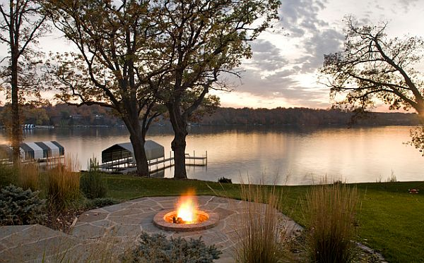lake house with an outdoor patio and firepit
