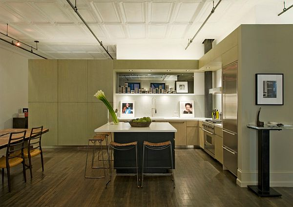 A corner loft kitchen with neutral colors that charm