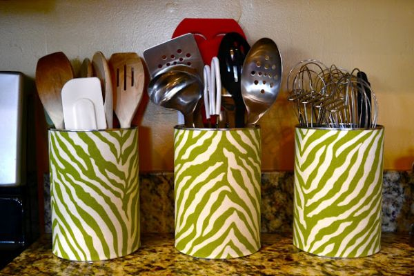 Old cans make great kitchen utensil holders