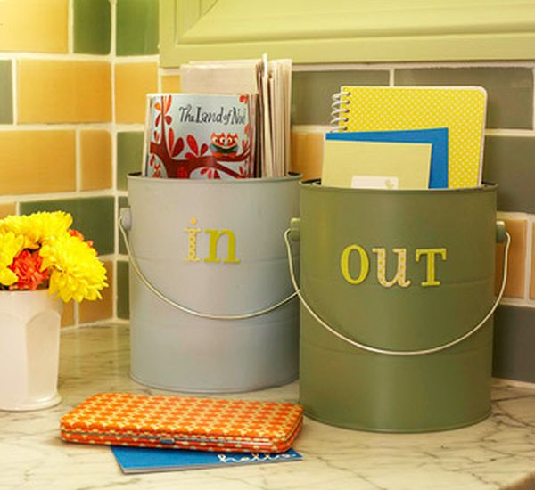 Upcycled paint cans used as storage containers