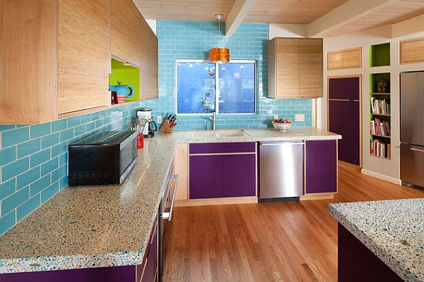 Purple cabinet doors with bright turquoise backsplash
