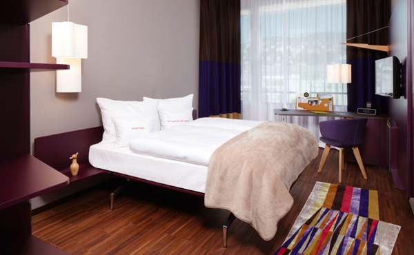 purple themed hotel room