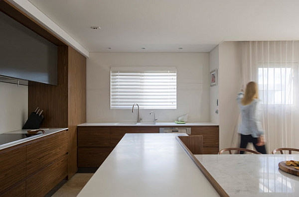 simple clean lines kitchen Small Space Solutions: Hidden Kitchen from Minosa Design