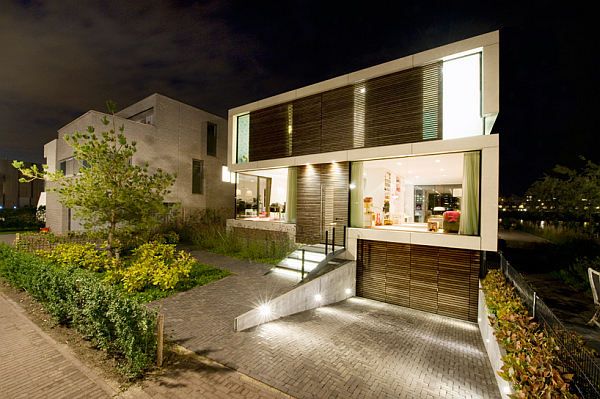 Single family dutch home combines flowing style with for Underground garage plans