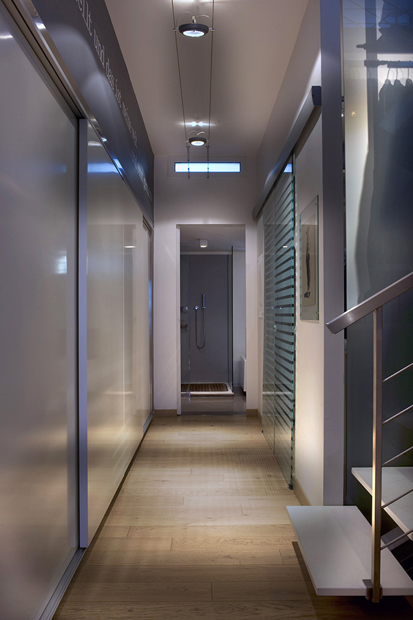 ultra modern hallway with bathroom at the end