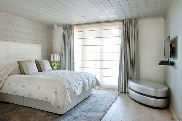 Rustic one oak chalet in the french alps charms with its touch of modernity for Deco chambre bois de rose