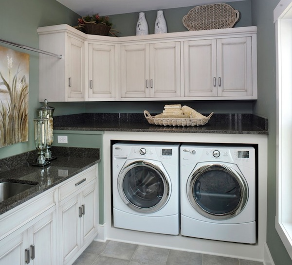 white washed cabinetry laundry room