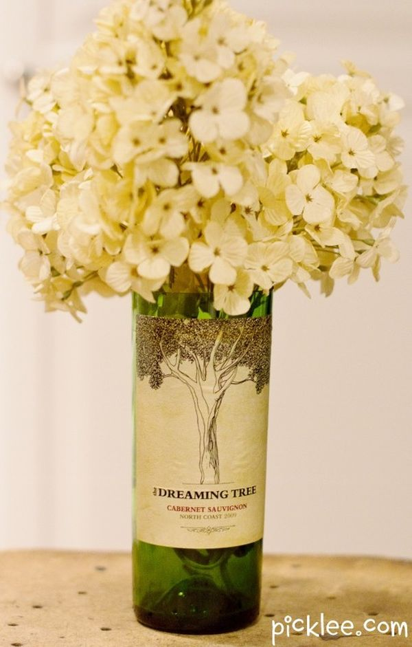 An old wine bottle used as a beautiful vintage vase