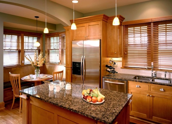 Wood blinds in this kitchen create a traditional look
