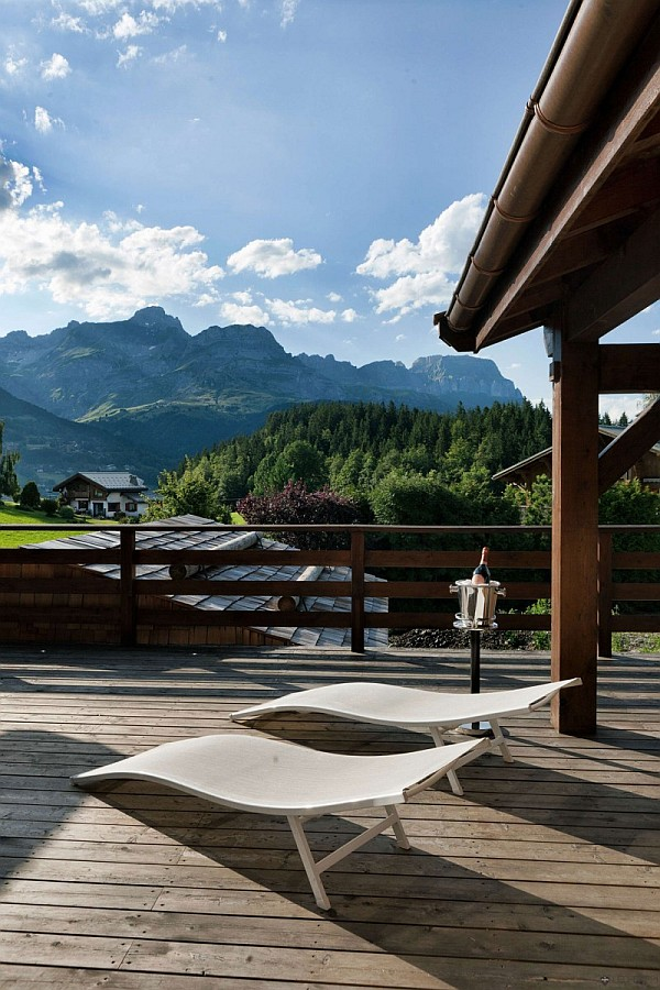 wooden deck with sun loungers