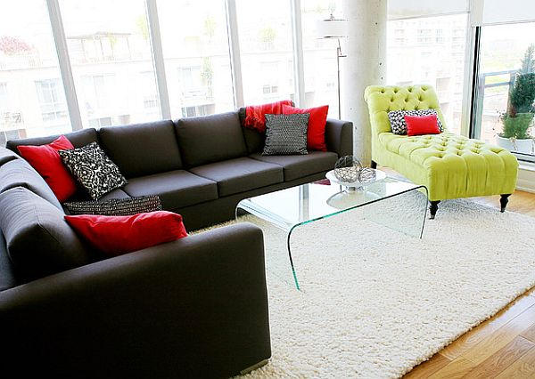 Yellow lounge and black L-shaped couch