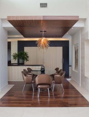 Beautiful ceiling creates a virtual island of wood to accommodate the dining area