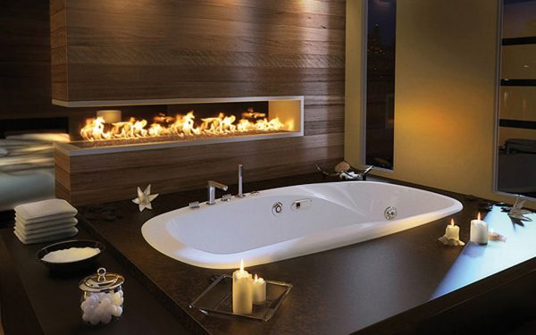 Beautiful modern fireplace lights up this bath area