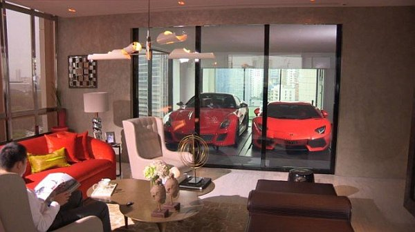 Cool garage integrated into the living room at the hamilton towers decoist - Car interior design ideas ...