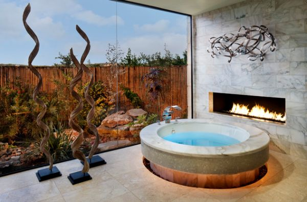 Cool bath tub design with an adjacent fireplace