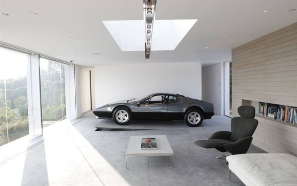 Parked to perfection stunning car garage designs for Luxury garage interiors