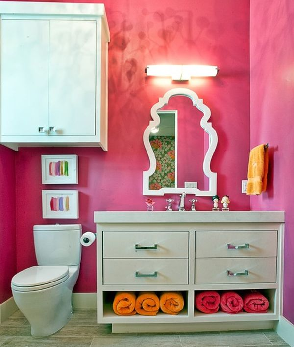 Fabulous mirror and fascinating color make this an ideal bathroom space for most girls!