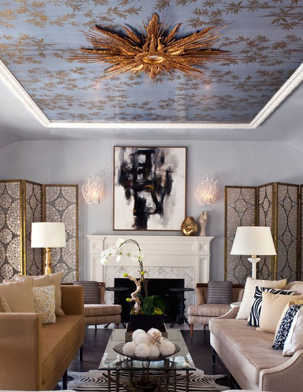 Gold-leafed starburst mirror on the ceiling steals the show in this royally styled study