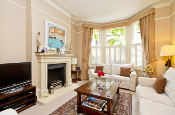Half shutters and beautiful blinds offer a lovely look to this room