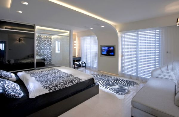 Innovative ceiling design gives this minimalist bedroom a futuristic feel