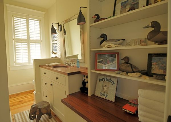 Kid's bathroom idea that incorporates shelf space and a mahogany countertop