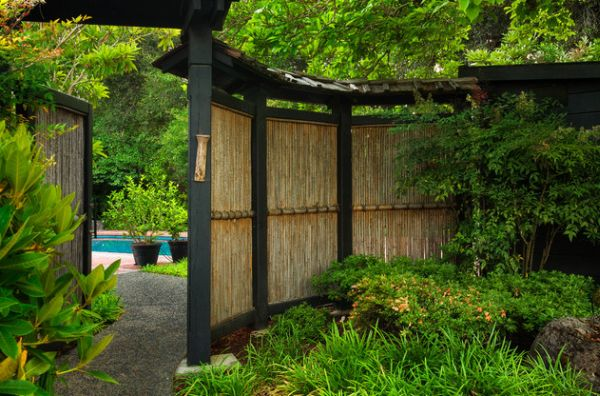 Natural bamboo fence adds an element of inimitable style to this garden