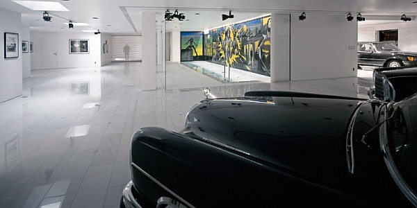 Ravishing modern garage filled with amazing works of art and vintage cars
