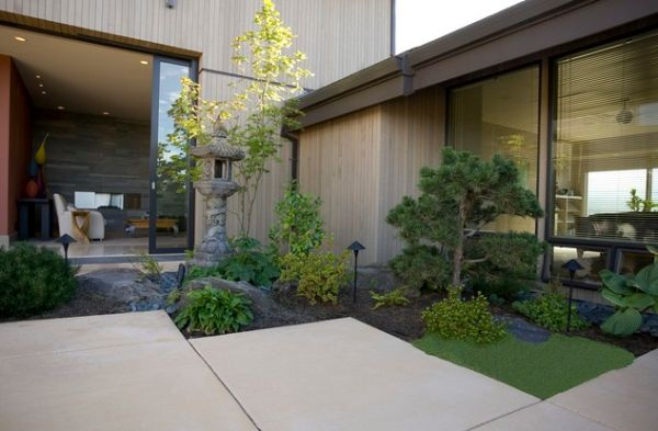 Small and compact Japanese corner garden offers an exquisite and polished appearance
