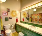 Stunning kids' bathroom with beautiful repurposed green cabinets
