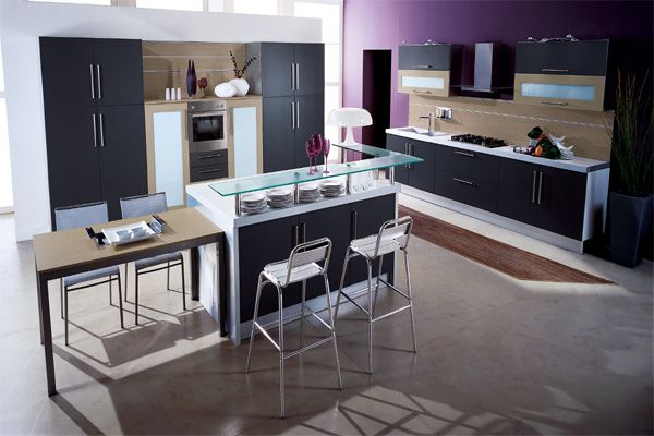 Stylish kitchen with glass countertop incorporates several textures 10 Kitchen Color Schemes for the Modern Home