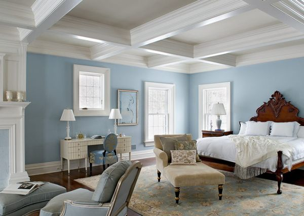 Stylish light ceiling, cool blue walls and dark flooring offer lovely contrast to this weekend getaway bedroom