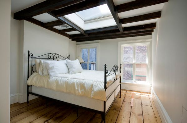 Tasteful bedroom ceiling incorporates skylight in its design