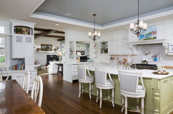 Varied ceiling and ergonomic lighting add beauty to this lovely East Coast style kitchen